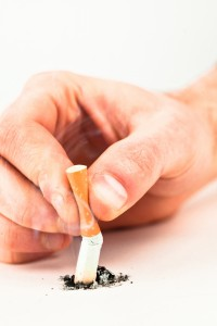 3597385-hand-crushing-a-cigarette